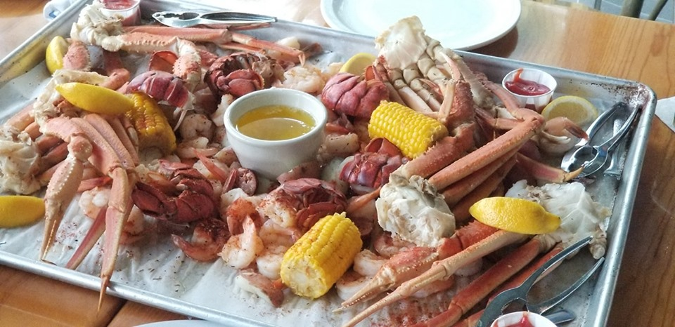 NOW FEATURING: The Seafood Feast - Over Seven Pounds of Seafood! Including Tail on Shrimp, Alaskan Snow Crab Legs, & Lobster Tails!