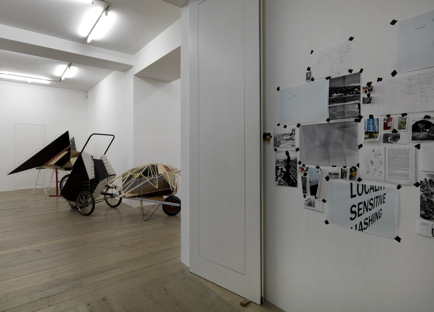 Installation view with research wall