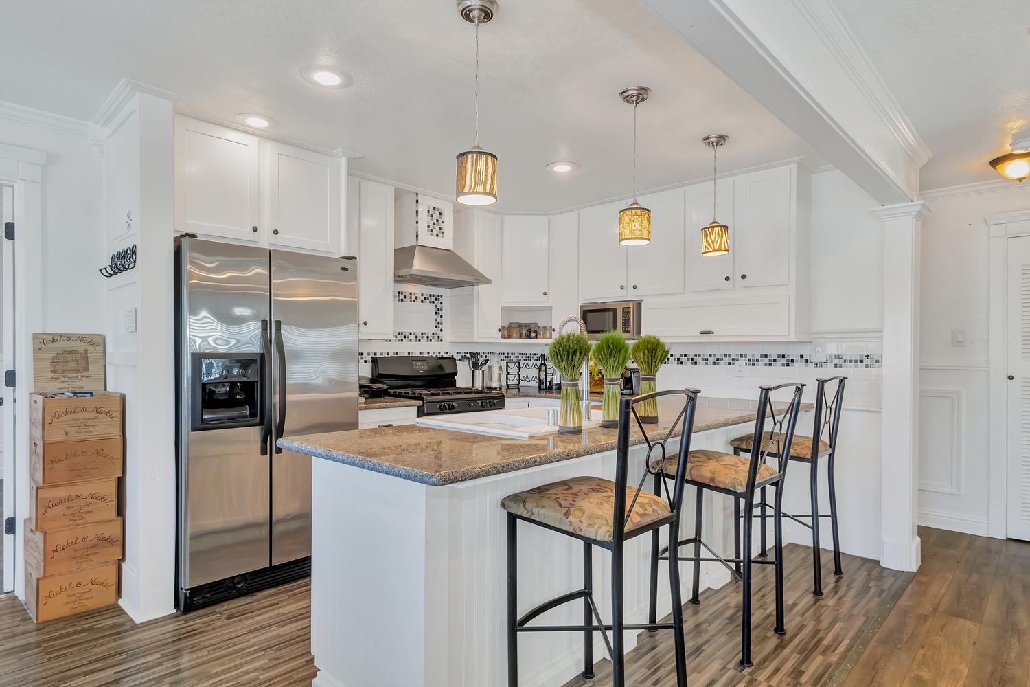 Updated kitchen with granite counters, farm-style basin sink and gorgeous tile backsplash.