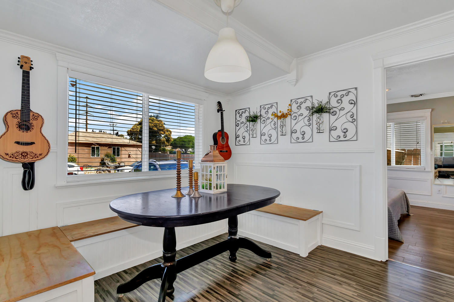 Enjoy the morning sunshine in this dining nook with built-in storage benches.