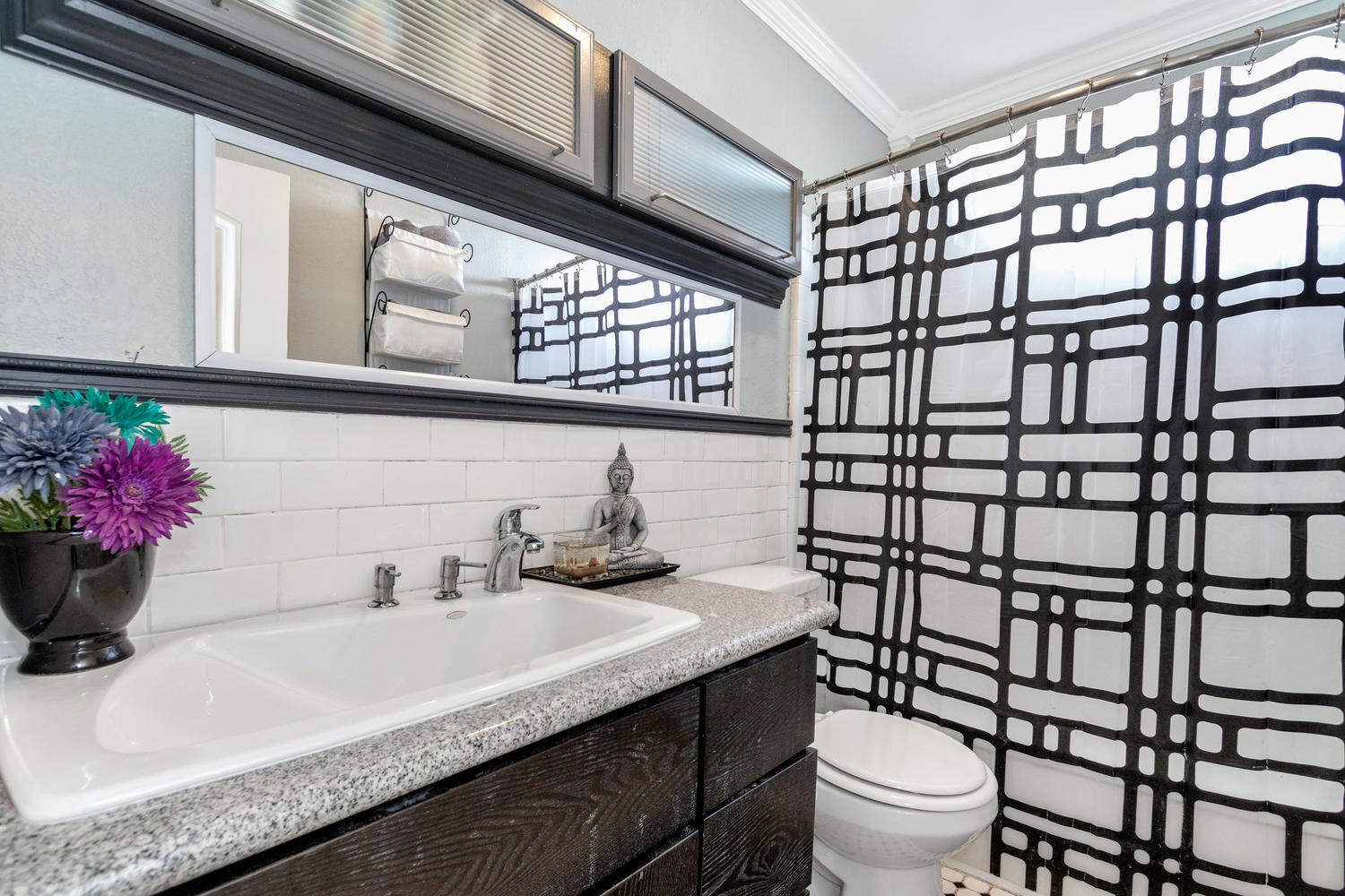 Adorable bathroom with updated finishes.
