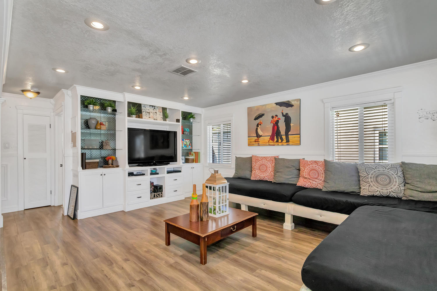 Family room features recessed lighting & built-in media center.