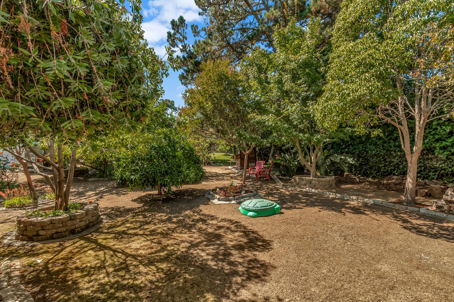 The lower level of backyard features a grove of Orange, Lemon, Maple and Crepe Myrtle trees for your enjoyment.