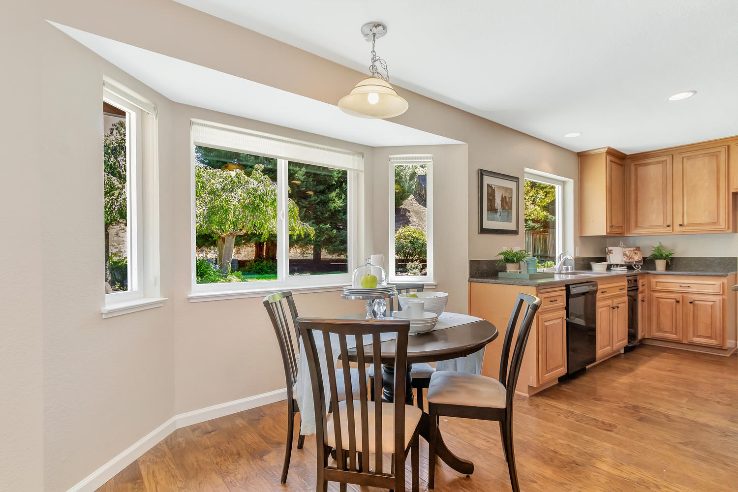 Dining nook off of kitchen offers a relaxing view.