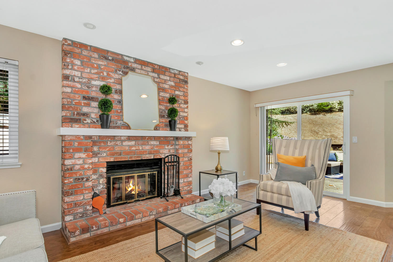 Beautiful floor-to-ceiling brick fireplace in Family Room.