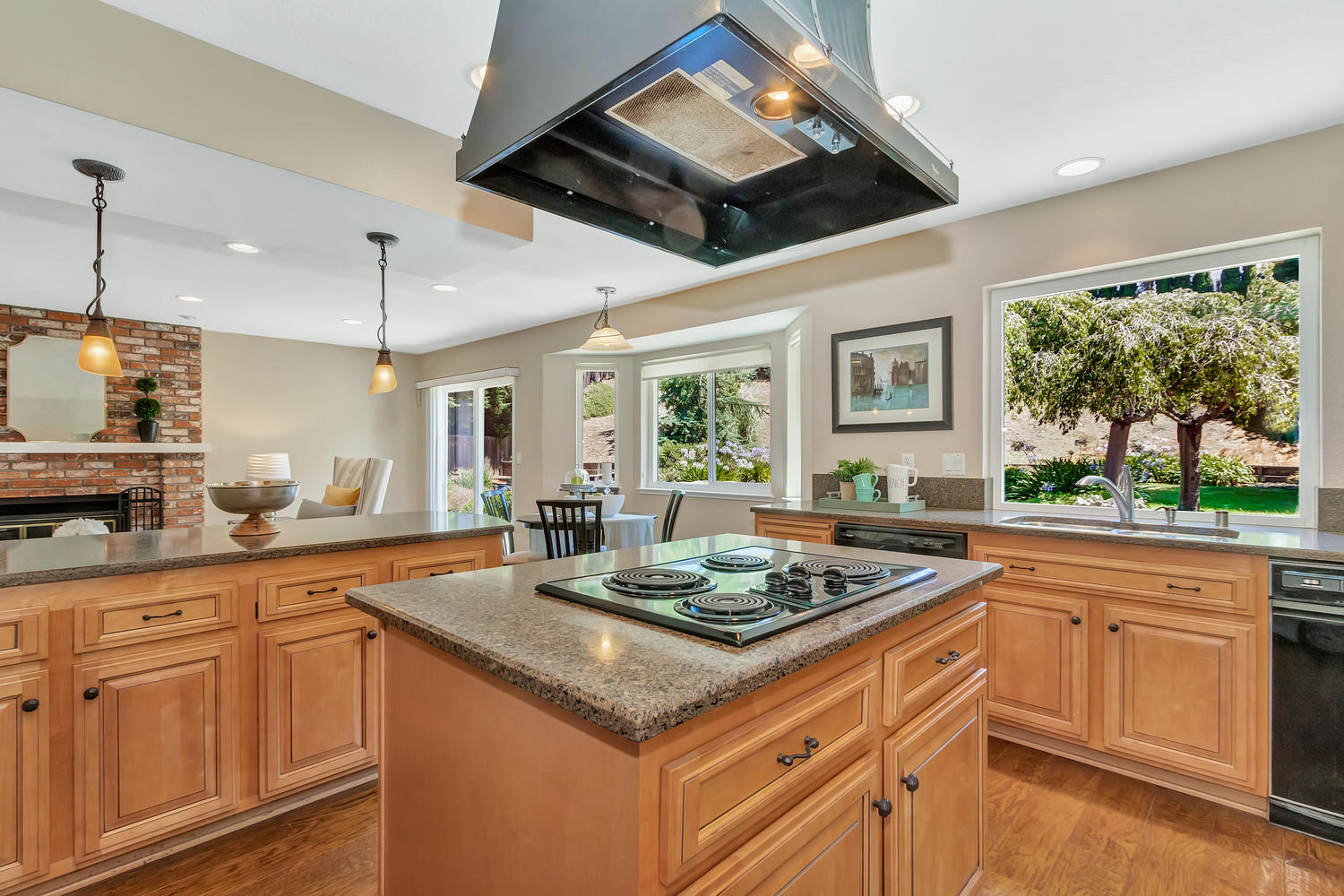 This spacious kitchen has beautiful backyard views & is filled with natural light!