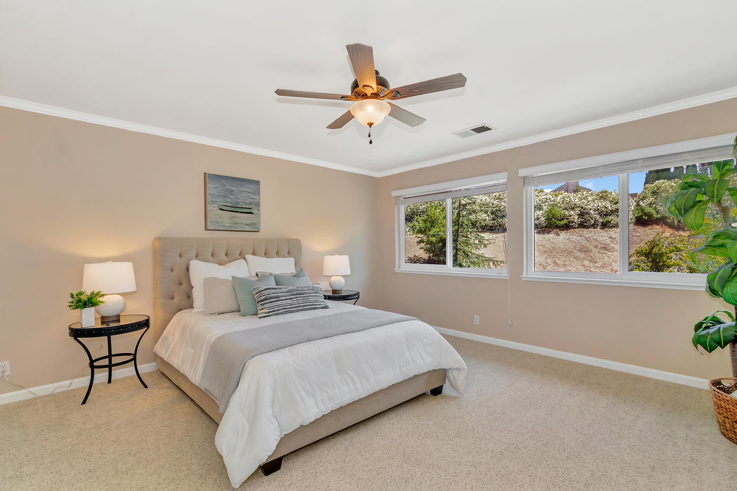 The large master suite has sweeping views and offers matching hidden walk-in closets.