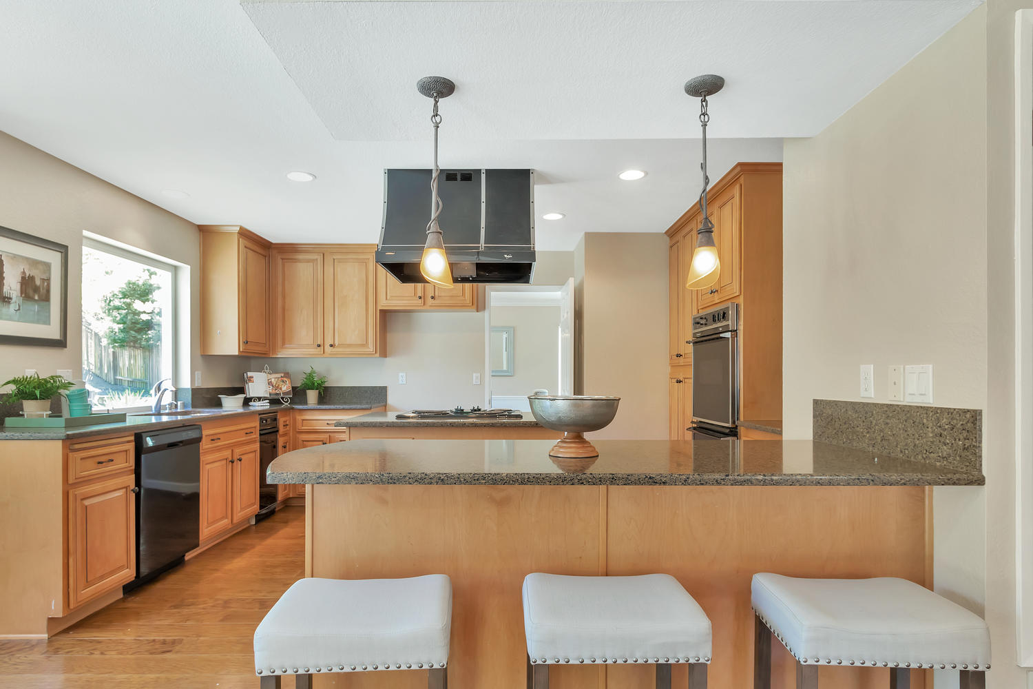 Remodeled kitchen includes island & granite counters.