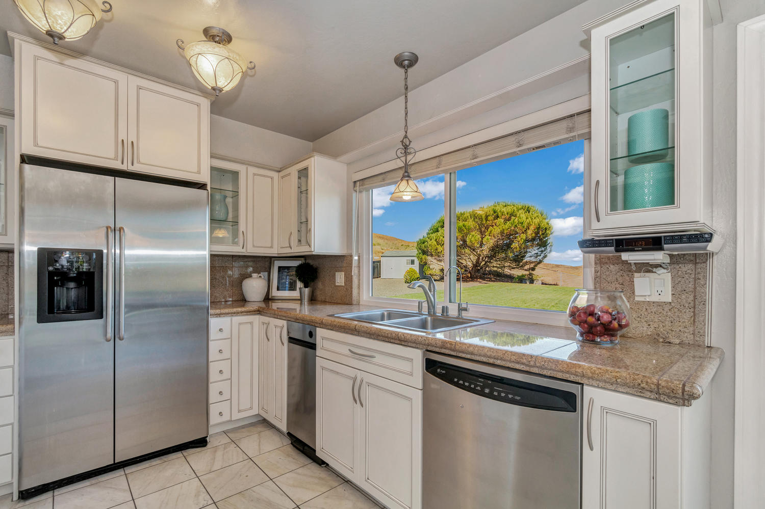 The remodeled kitchen offers ample storage & stunning views!