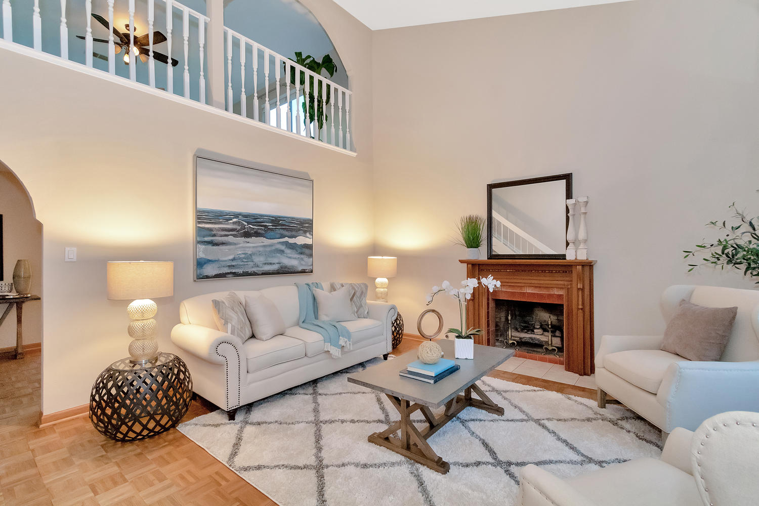 Spacious living room has vaulted ceilings and opens to upstairs family room.