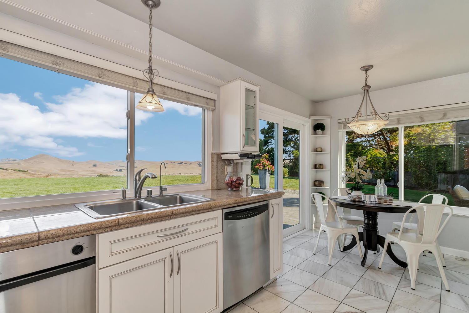 Sweeping scenic views and incredible natural light fill the beautifully remodeled kitchen!