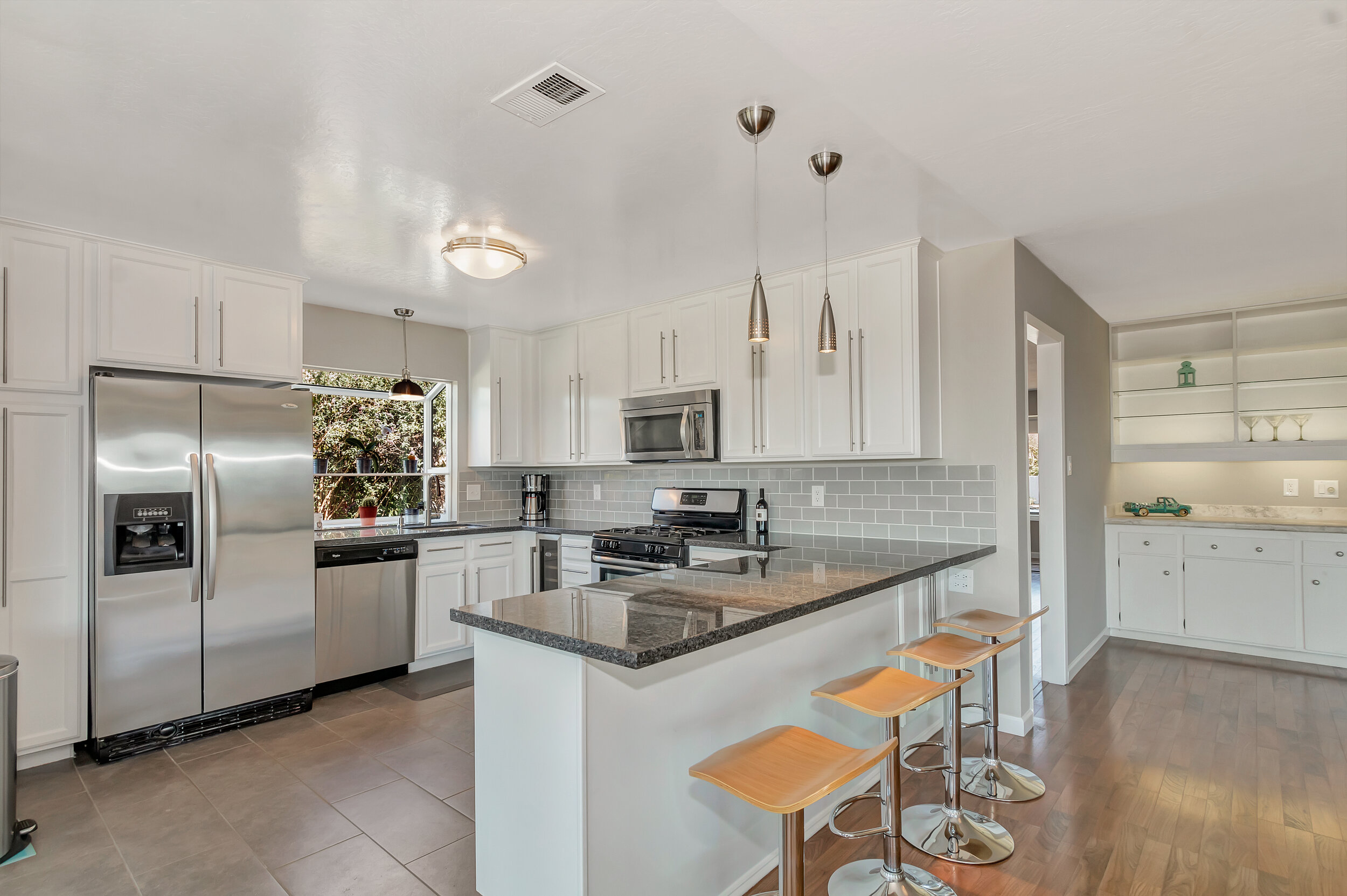 The kitchen has been fully remodeled & features stainless steel appliances.
