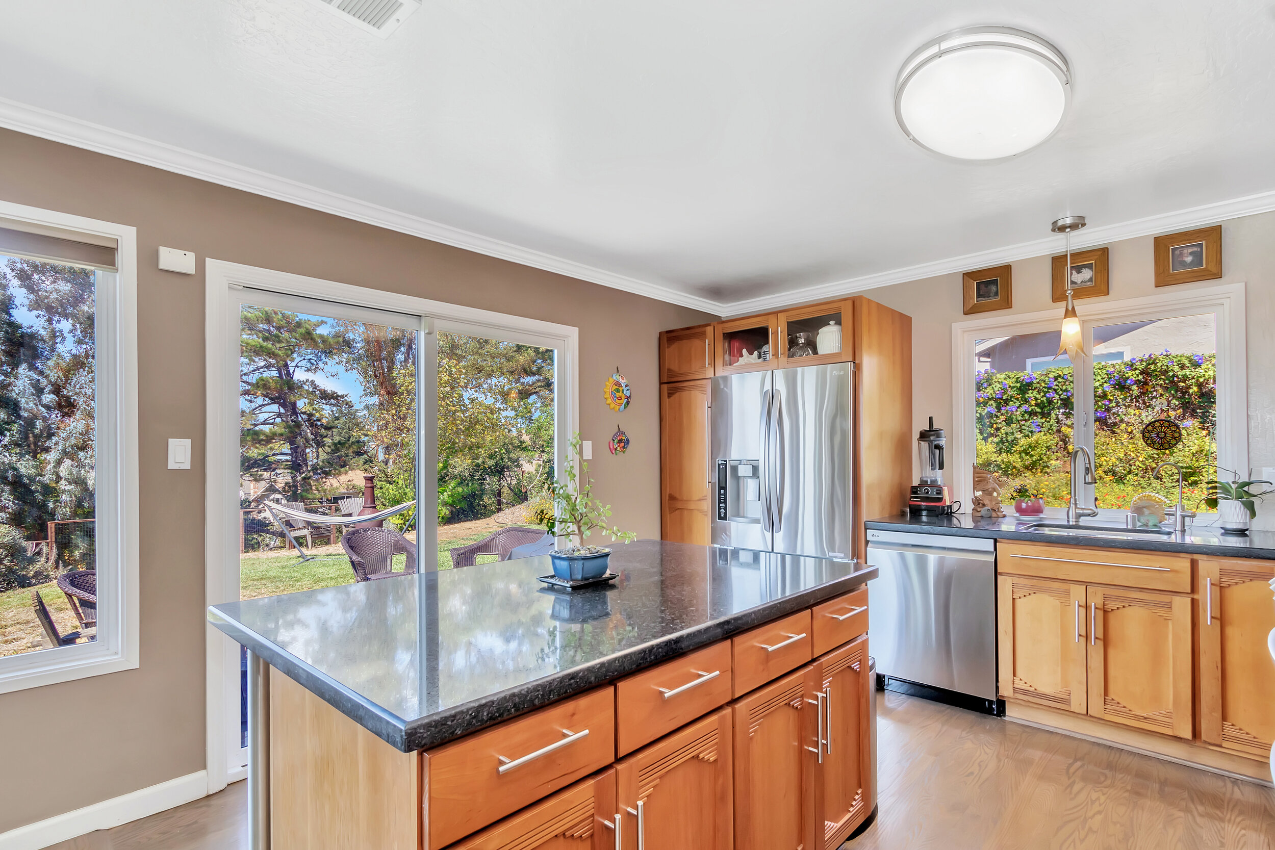 Remodeled kitchen features LG stainless steel appliances, genuine oak floors and beautiful black Sil stone countertops.