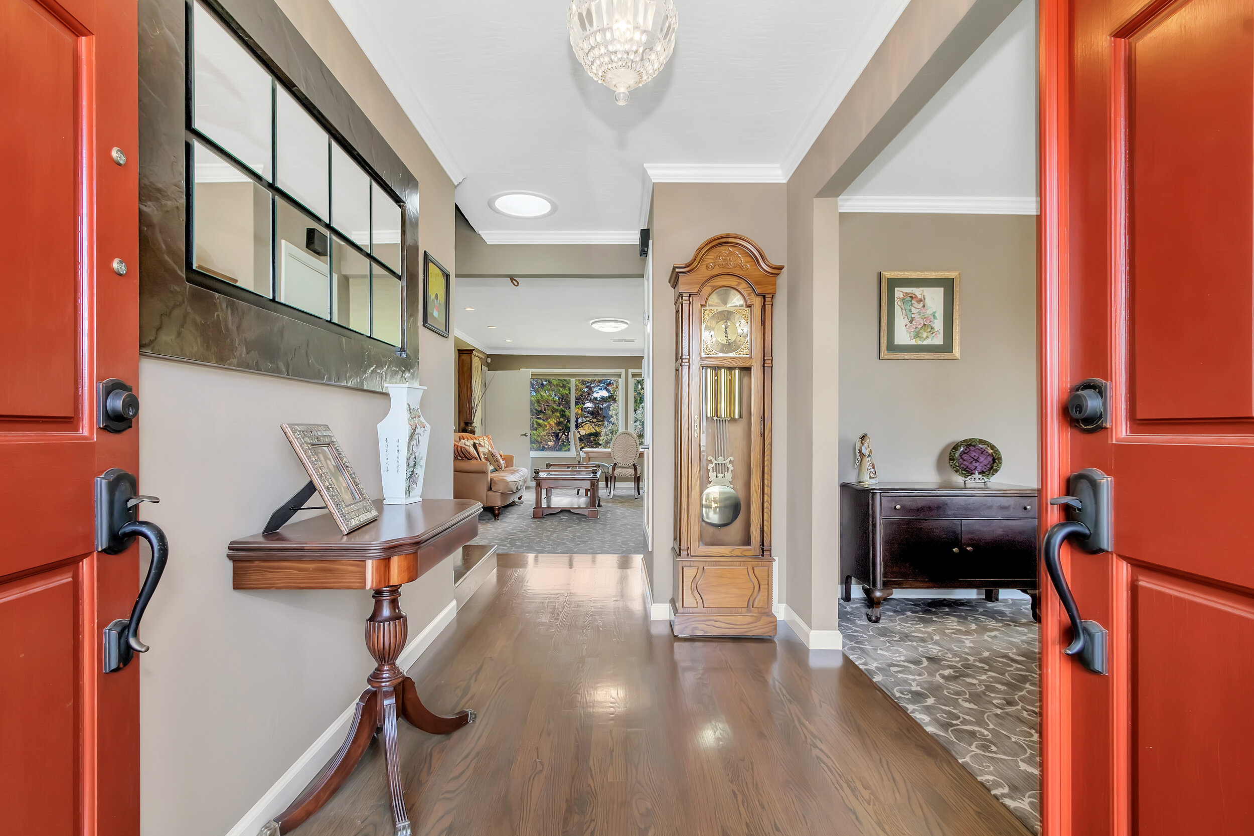 Double doors open to beautiful genuine oak floors and inlaid woven carpet.