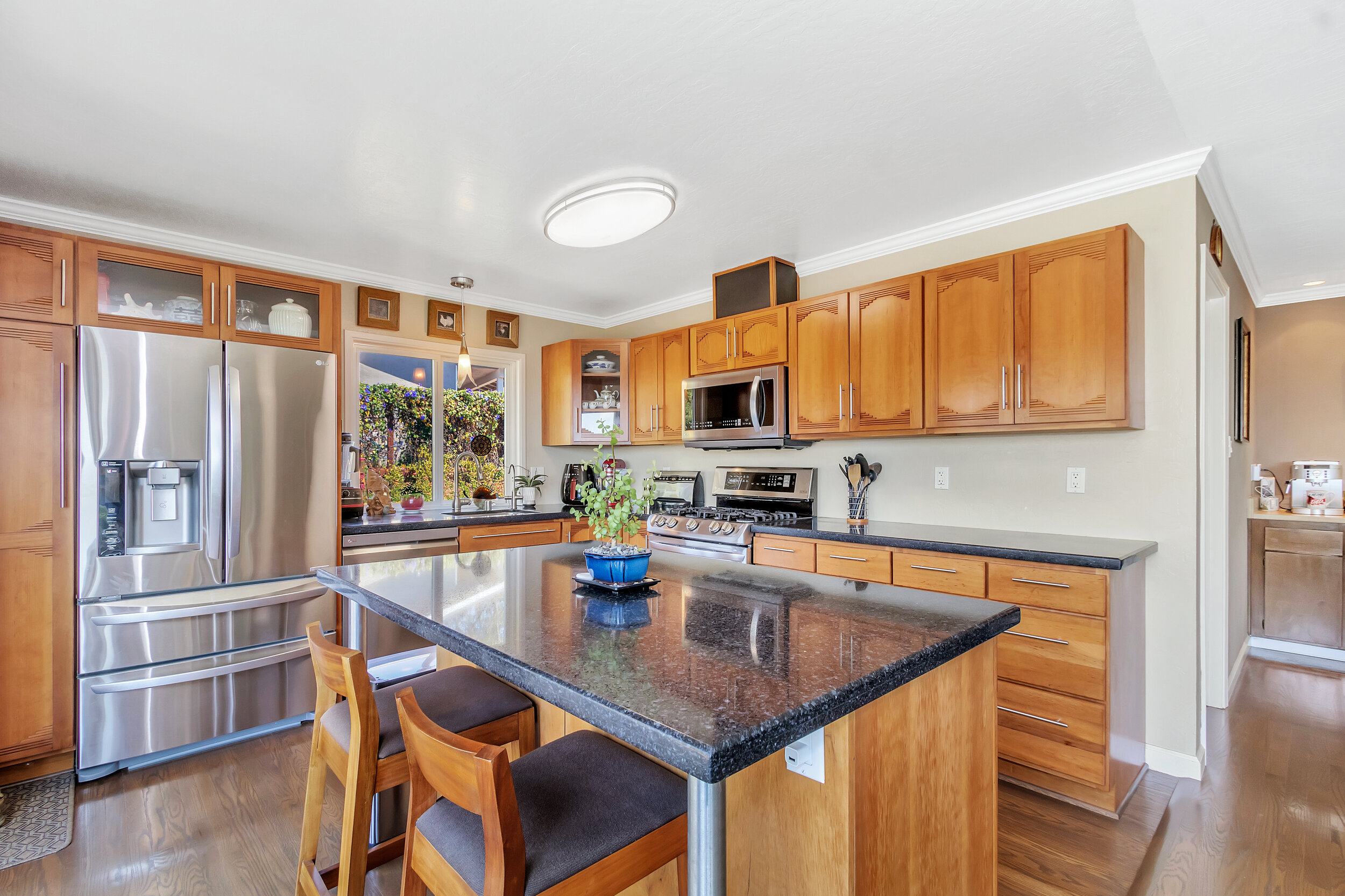 Recently remodeled kitchen features Stainless Steel LG appliances, black Silestone counters and Cherrywood cabinets.