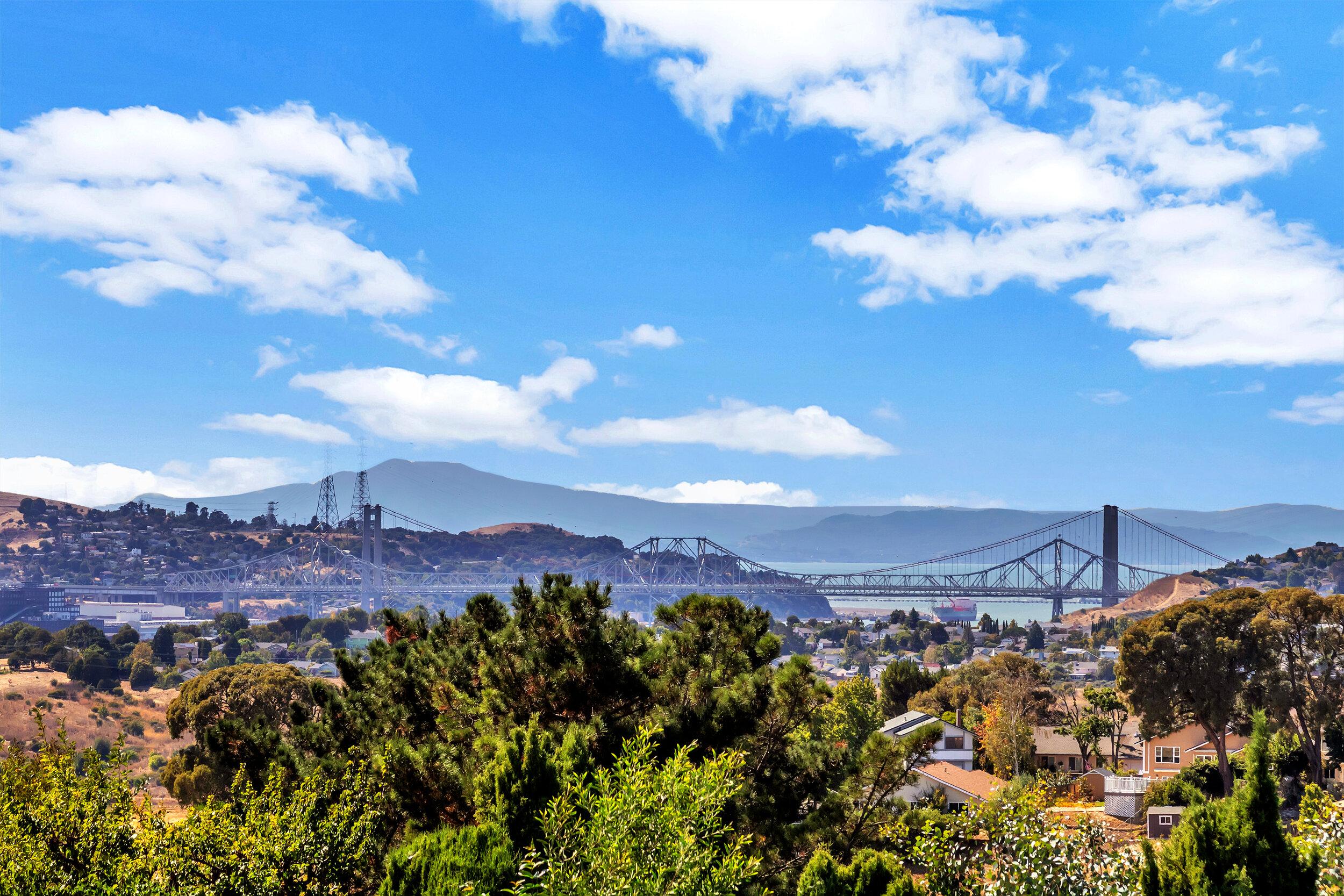 Stunning water & bridge views form your own backyard!