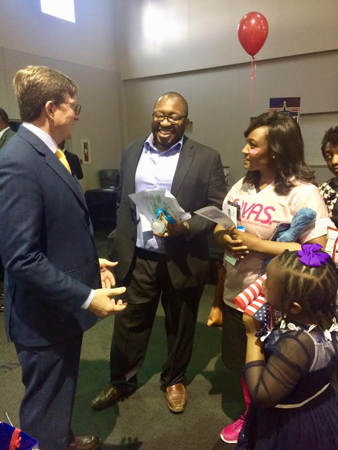 David Baria talking with voters