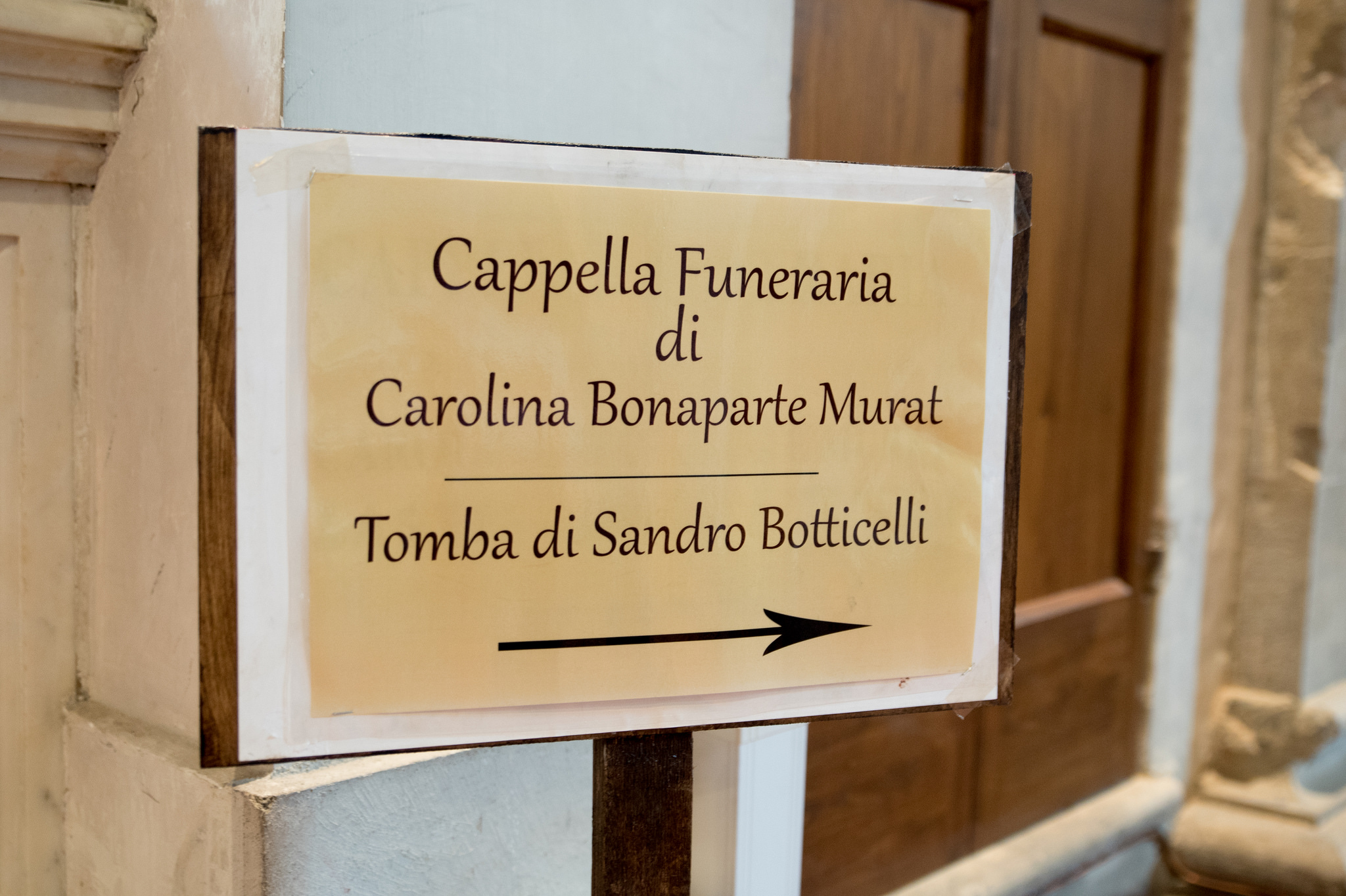 A sign directs visitors to the Botticelli tomb.