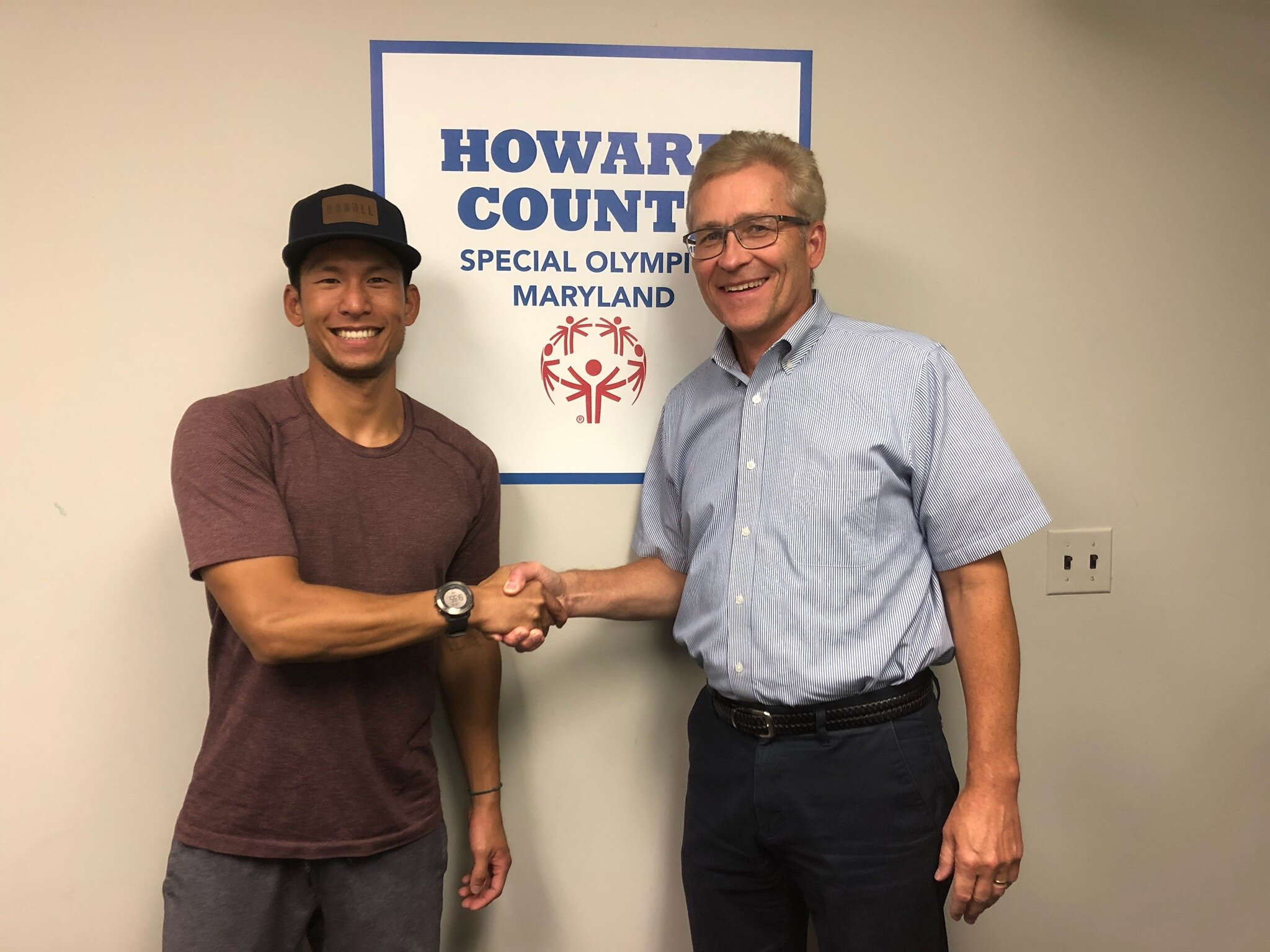 Pictured above: Wilson Pak, General Manager of 12 Labours CrossFit & Bob Baker, Director of Special Olympics Maryland Howard County