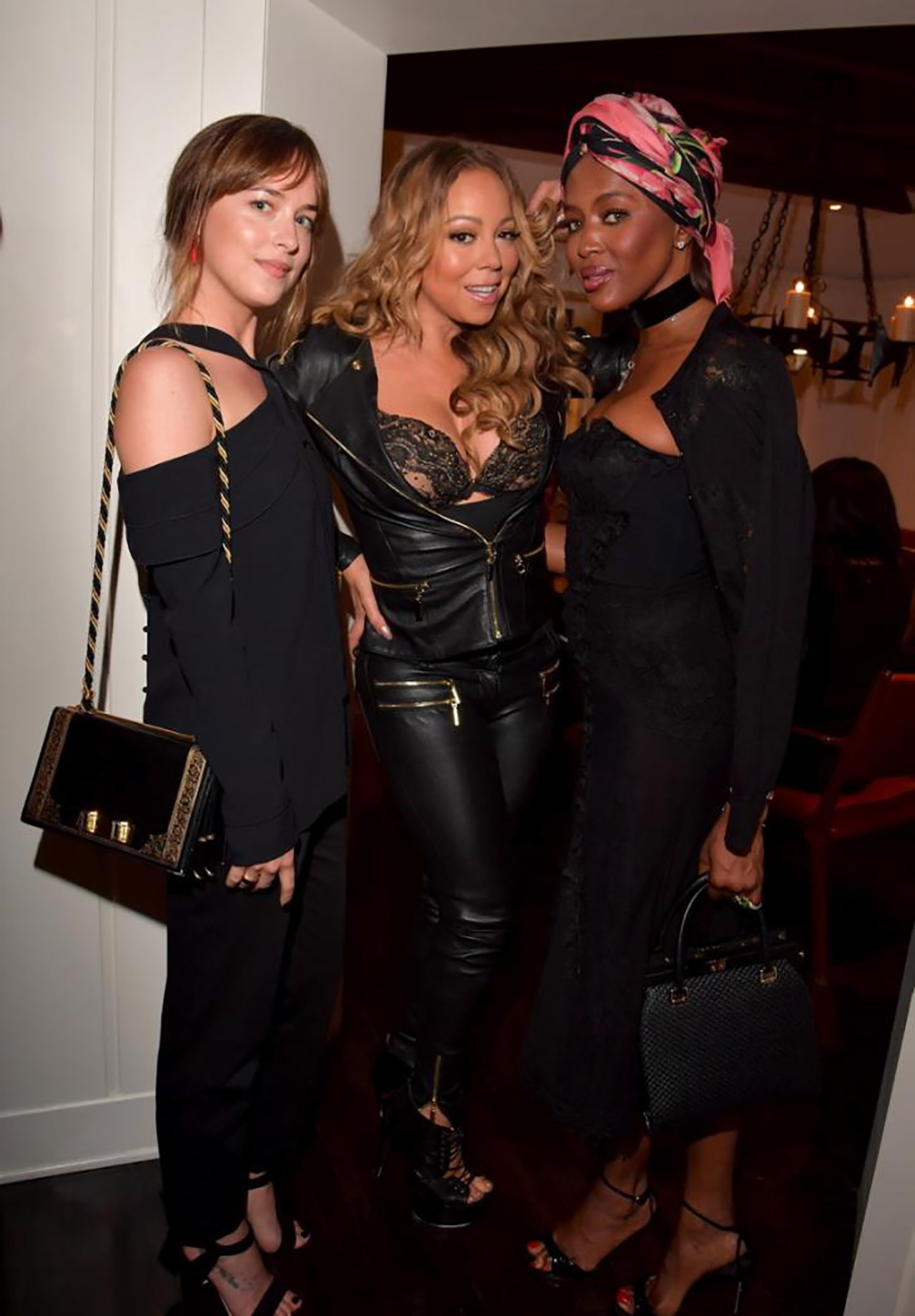 Dakota Johnson, Mariah Carey And Naomi Campbell ©Lester Cohen, Getty Images