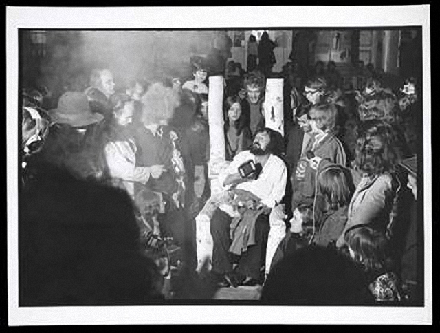 Harald Szeemann (seated) on the last night of documenta 5: Questioning Reality–Image Worlds Today at Museum Fridericianum, 1972. The Getty Research Institute, 2011.M.30. Photo: Balthasar Burkhard