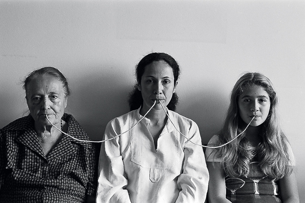 Anna Maria Maiolino, Por um Fio (By a Thread), from the Fotopoemação (Photopoemaction) series, 1976, archival inkjet print, 22 3/8 x 31 1/8 in. (57 x 79 cm.), photo by Regina Vater   ANNA MARIA MAIOLINO  August 4–December 31, 2017  MOCA Grand Avenue  Curators: Bryan Barcena and Helen Molesworth