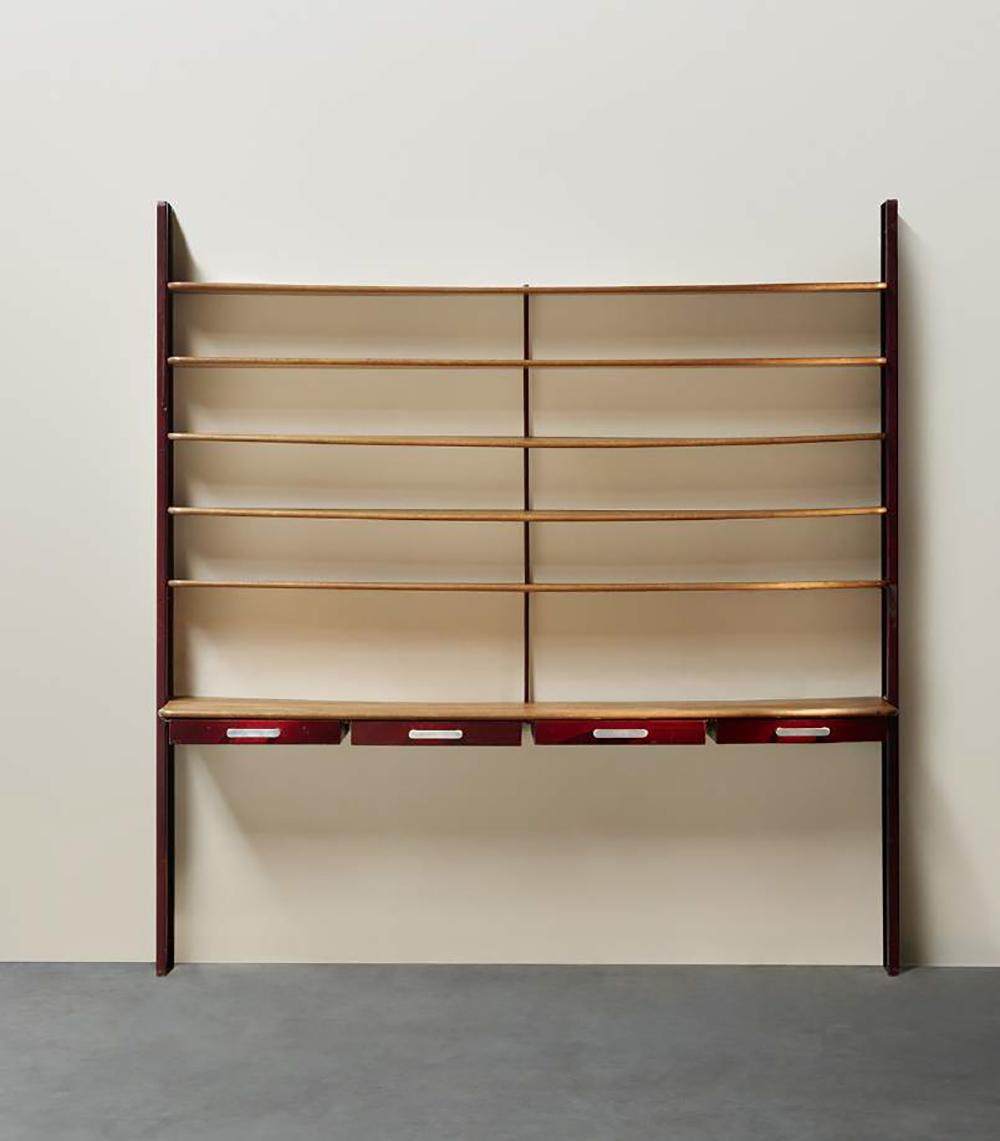 Jean Prouvé (1901-1984), Console-bookcase, Ca. 1930 Red lacquered steel structure and drawers, cast aluminium handles, oak shelves / H. 102 x W. 98 x D. 19.7 in. © Marie Clérin / Laffanour Galerie Downtown, Paris