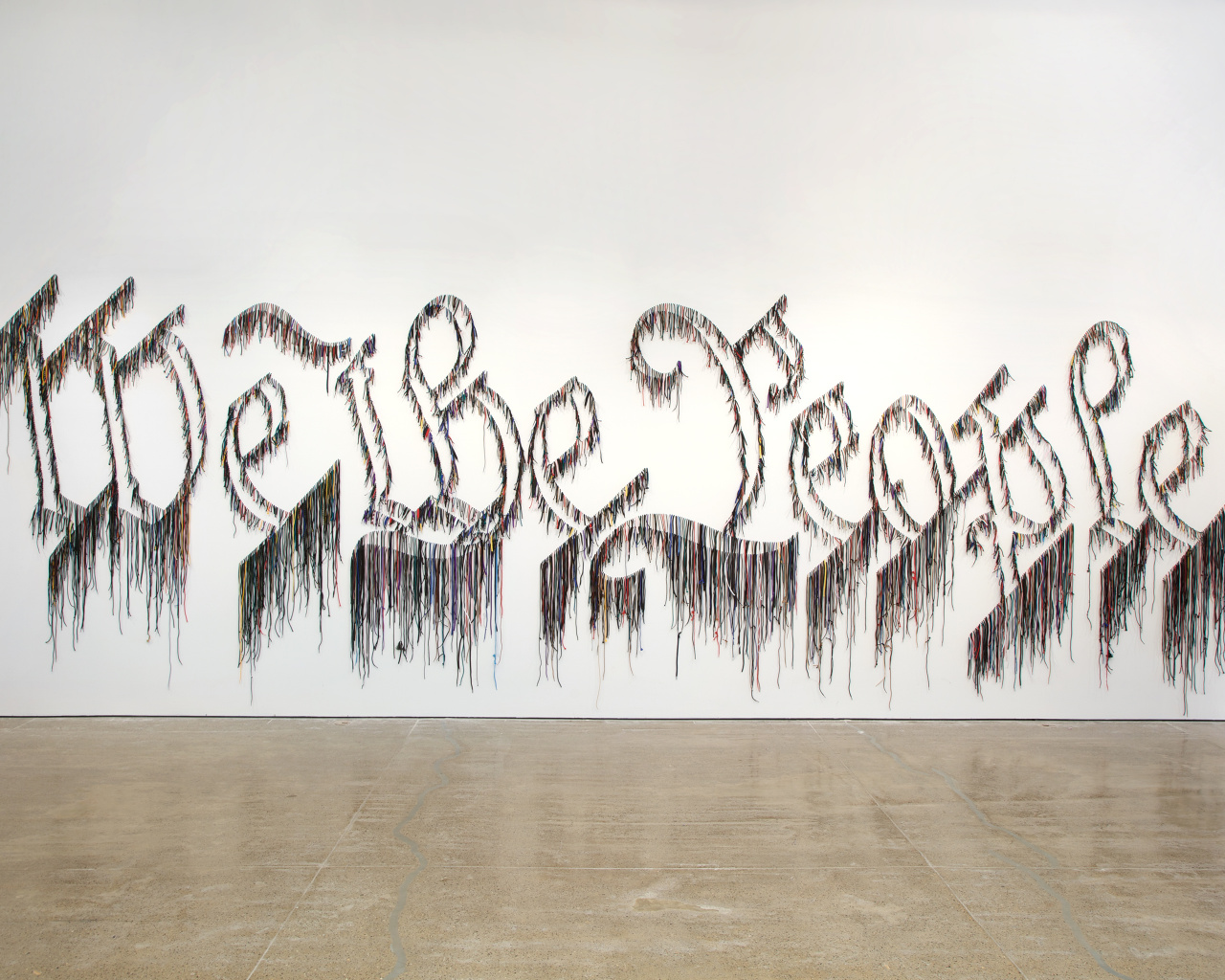 Nari Ward, We the People, 2011. Shoelaces, 96 x 324 in (243.8 × 594.4 cm). In collaboration with the Fabric Workshop and Museum, Philadelphia. Collection Speed Art Museum, Louisville, KY; Gift of the Speed Contemporary, 2016.1. © The Speed Art Museum, Louisville, KY