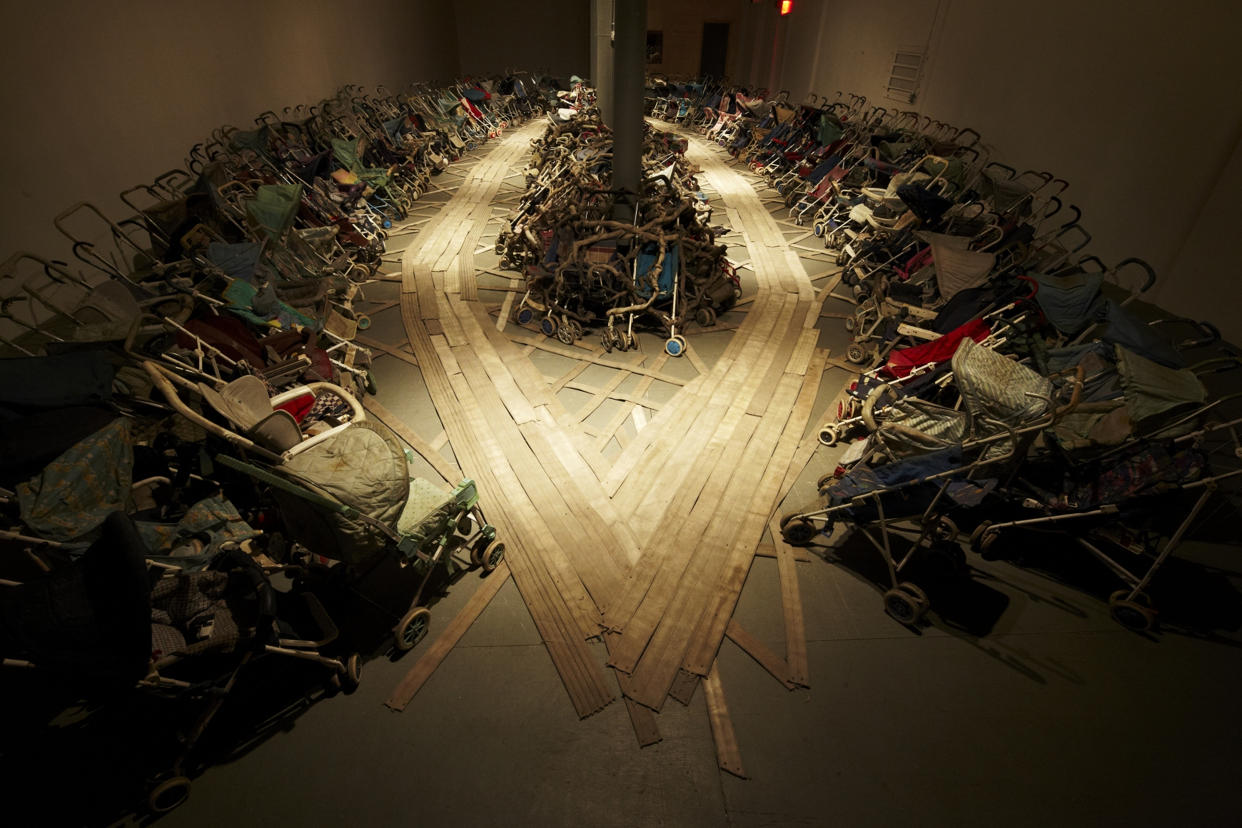 """Nari Ward, Amazing Grace, 1993. Approx. 300 baby strollers and fire hoses, dimensions variable. Installation view: """"NYC 1993: Experimental Jet Set, Trash and No Star,"""" New Museum, New York, 2013. Courtesy the artist and Lehmann Maupin, New York and Hong Kong. Photo: Jesse Untracht-Oakner"""