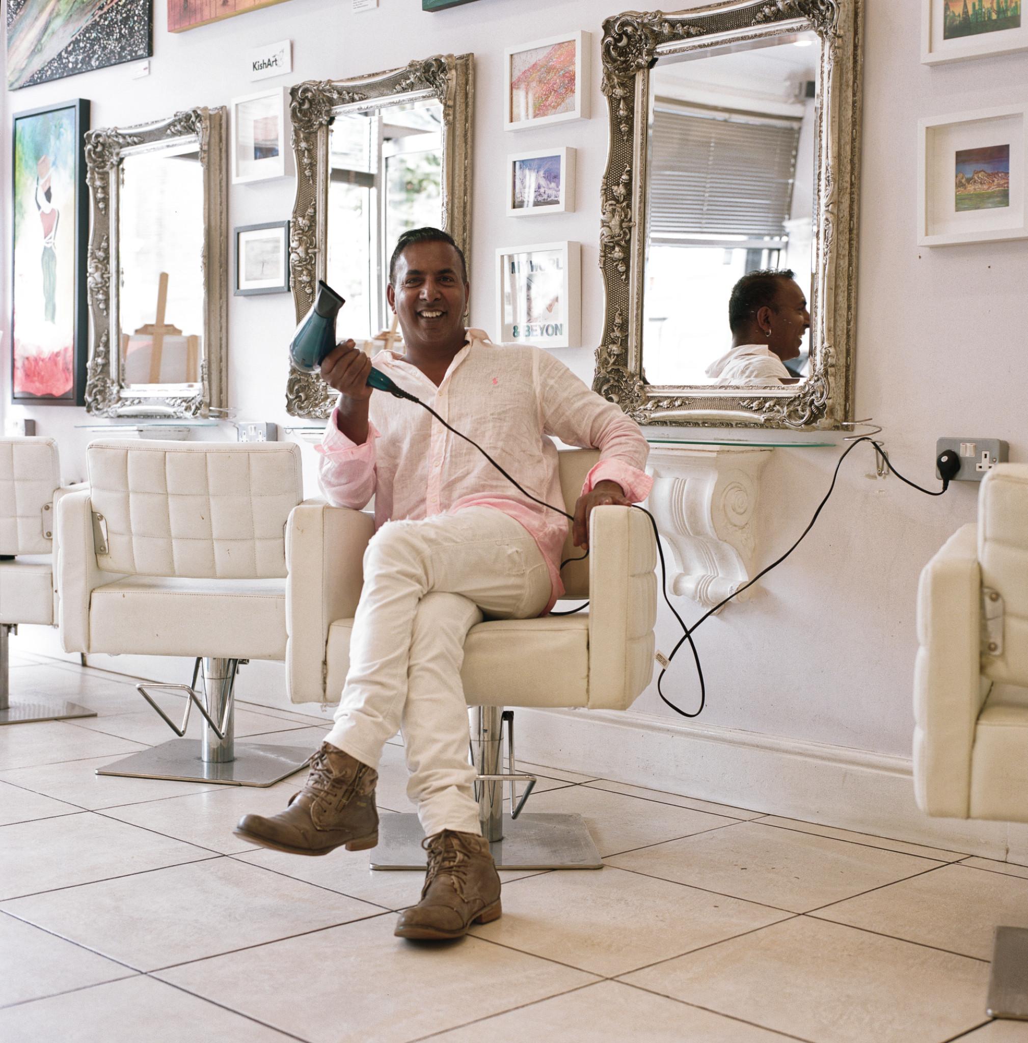 Kish Soobramaney, proprietor of La Zara Art Gallery and Hairdressers  Copyright Graham Land; taken 12th July, 2018