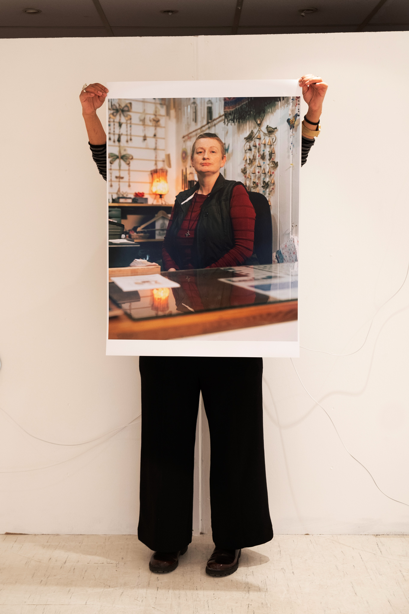 'B' holding up the A1 sized print of Carol, Croydon Buddhist Centre in THE LOFT exhibition space.  Taken by Graham Land, 29th March, 2019