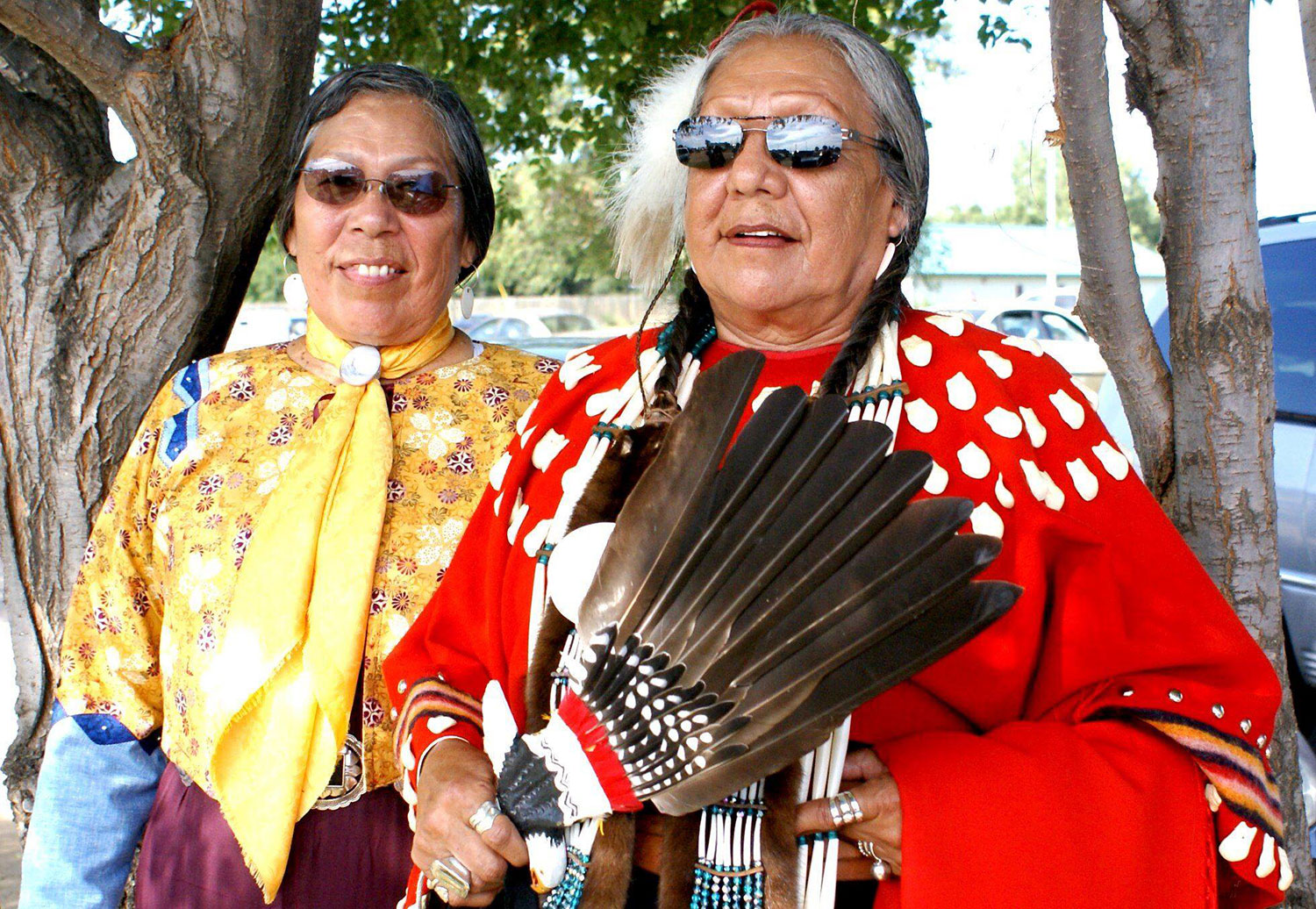 Madonna Thunder Hawk and her sister Mabel Ann Phillips Eagle Hunter in their beautiful regalia on the powwow trail