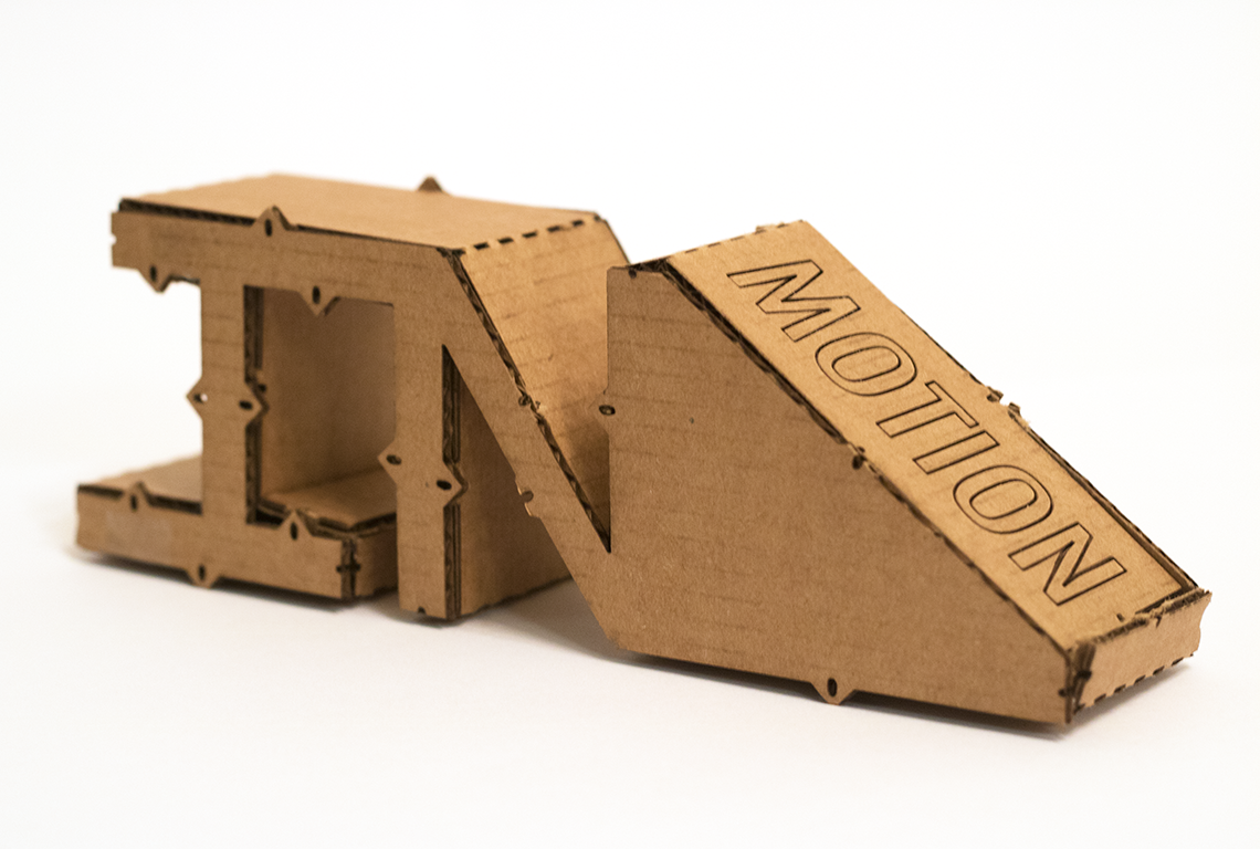 Physical cardboard model of the In Motion 3D icon. Cardboard was laser-cut, folded, and glued.