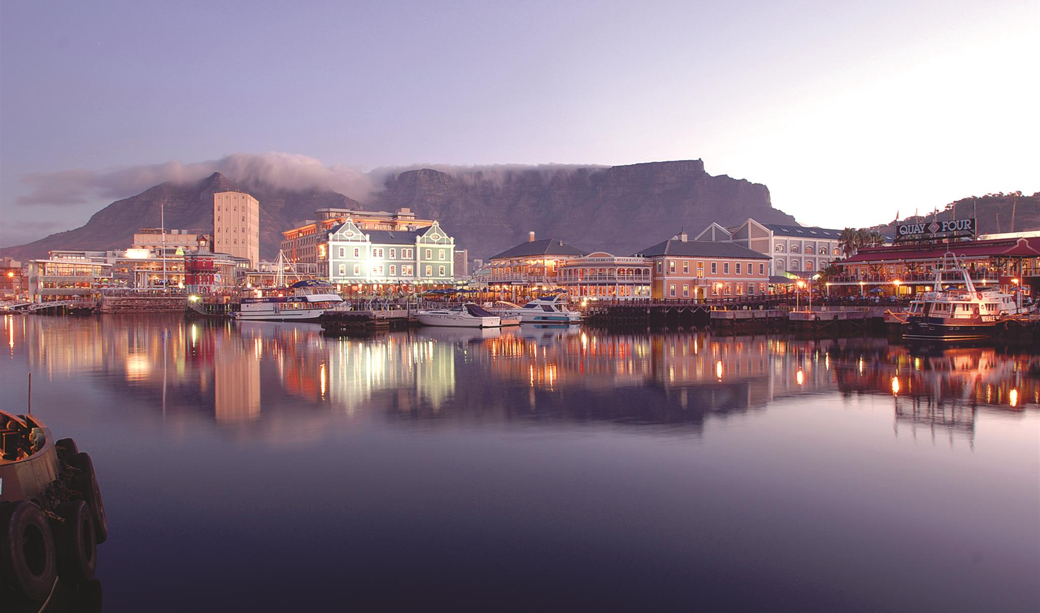dinner At the V&A waterfront: Karibu - Set between the picturesque view of Table Mountain and the tranquil blue waters of the Atlantic Ocean, Karibu affords you the opportunity to experience the vibrant flavours of South Africa and be part of our unique theatre of dining.