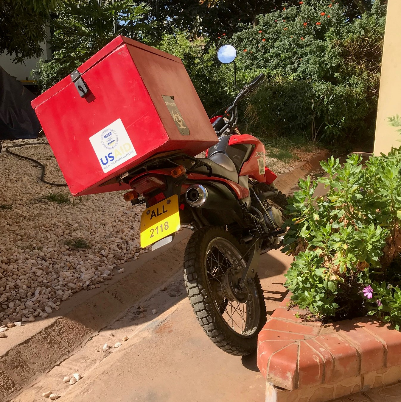 Samples are transported from the site to the lab by motorcycle to avoid traffic delays