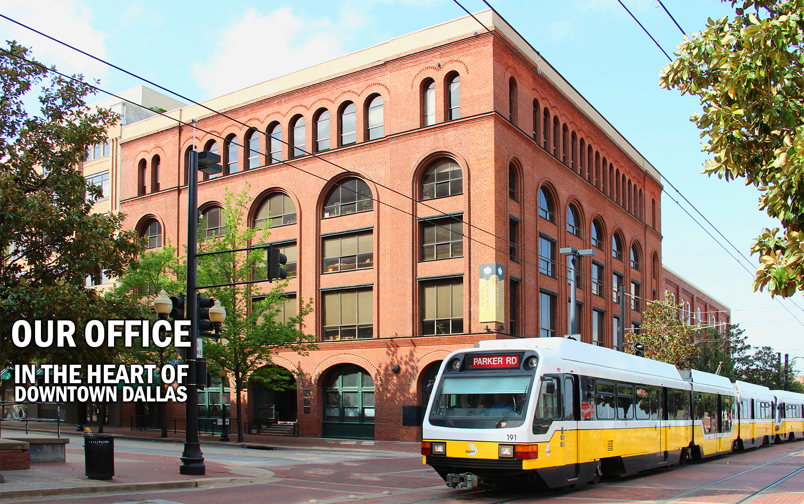 Our office exterior with DART train AND TEXT.jpg