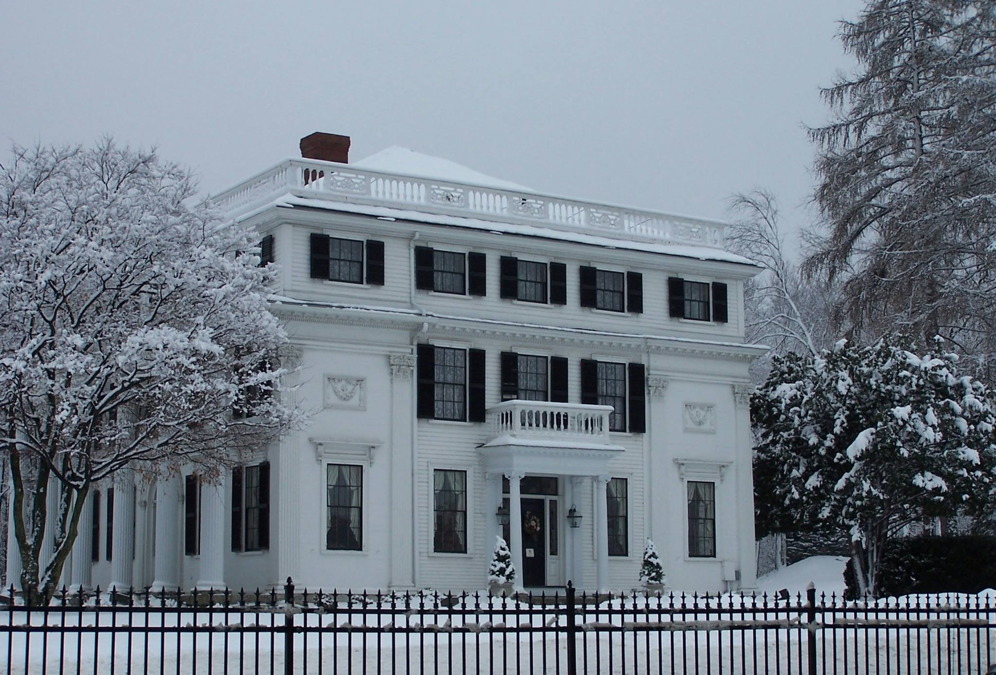 Elm Street side view with grounds covered in snow, winter. Photo: Mary Bowen, Asa Waters Mansion.