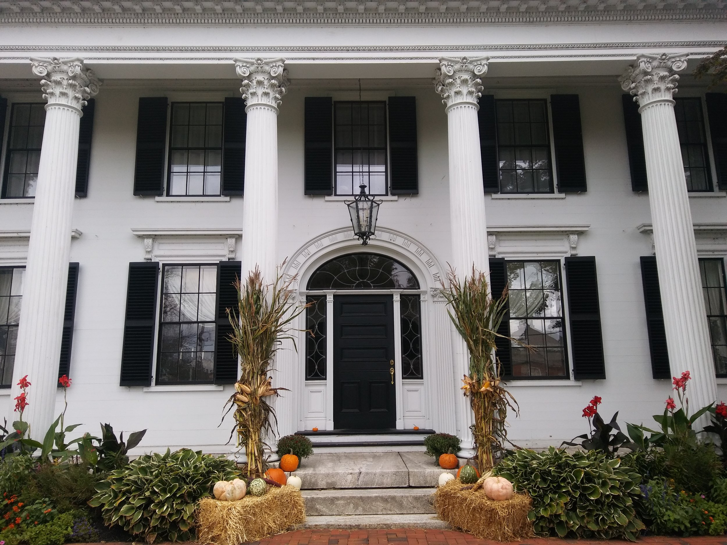 Main entrance with autumnal decor, fall 2018. Photo: Mary Bowen, Asa Waters Mansion.