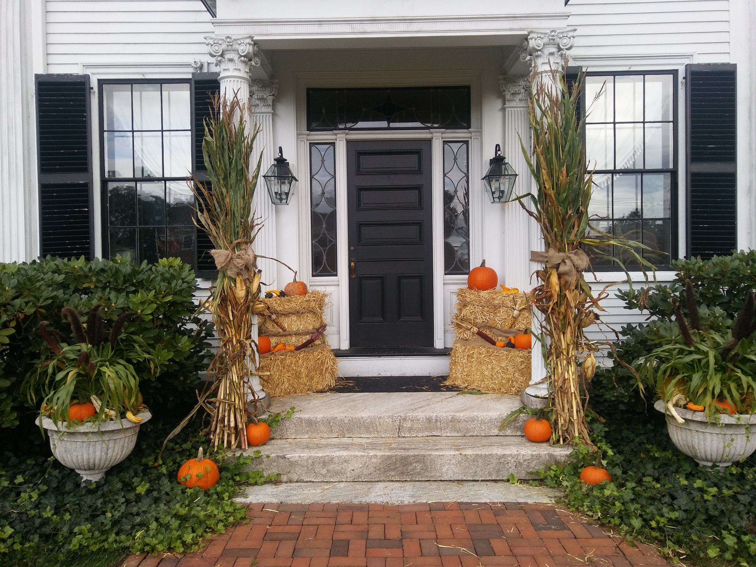 Elm Street side entrance with autumnal decor, fall 2018. Photo: Mary Bowen, Asa Waters Mansion.