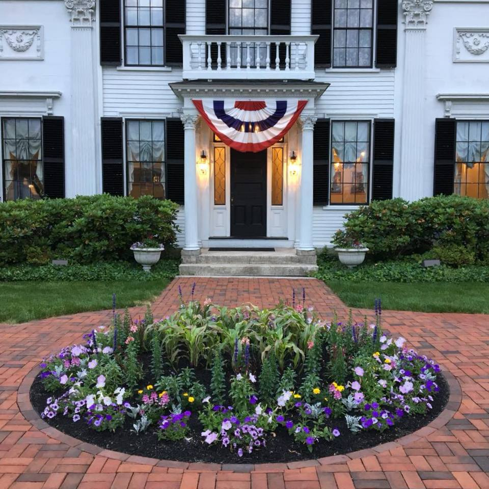 The Floral Circle that graces the Elm Street side path, early summer. Photo: Catherine Elliott, Asa Waters Mansion.
