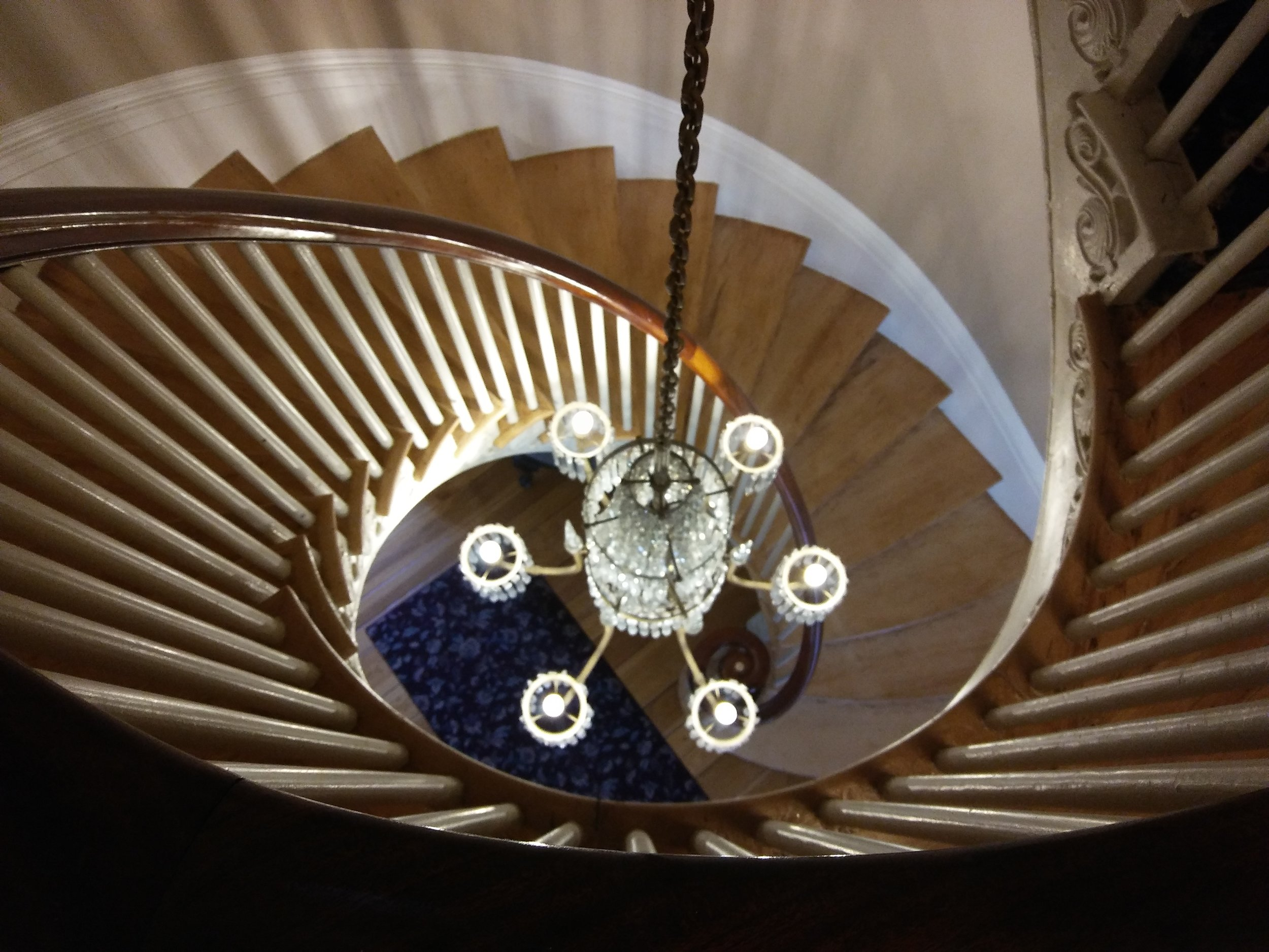 The Grand Staircase with central chandelier. Photo: Mary Bowen, Asa Waters Mansion.