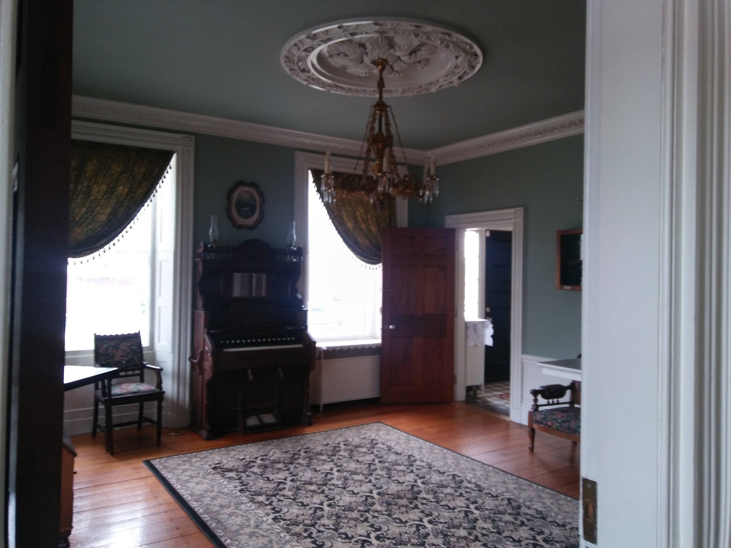 The historic East Parlor is the most authentic room in the house, and boasts the original pumpkin floor the Waters family had installed in the 1820s. Photo: Mary Bowen, Asa Waters Mansion.