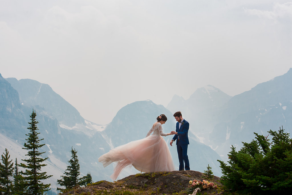 Photos by Abby + Dave  Our Montreal couple, Sarah and Thierry, traveled to Storm Mountain Lodge in Banff National Park for their romantic heli wedding. French romance filled the air atop majestic mountain peaks! This wedding is featured in print at Rocky Mountain Bride Magazine.