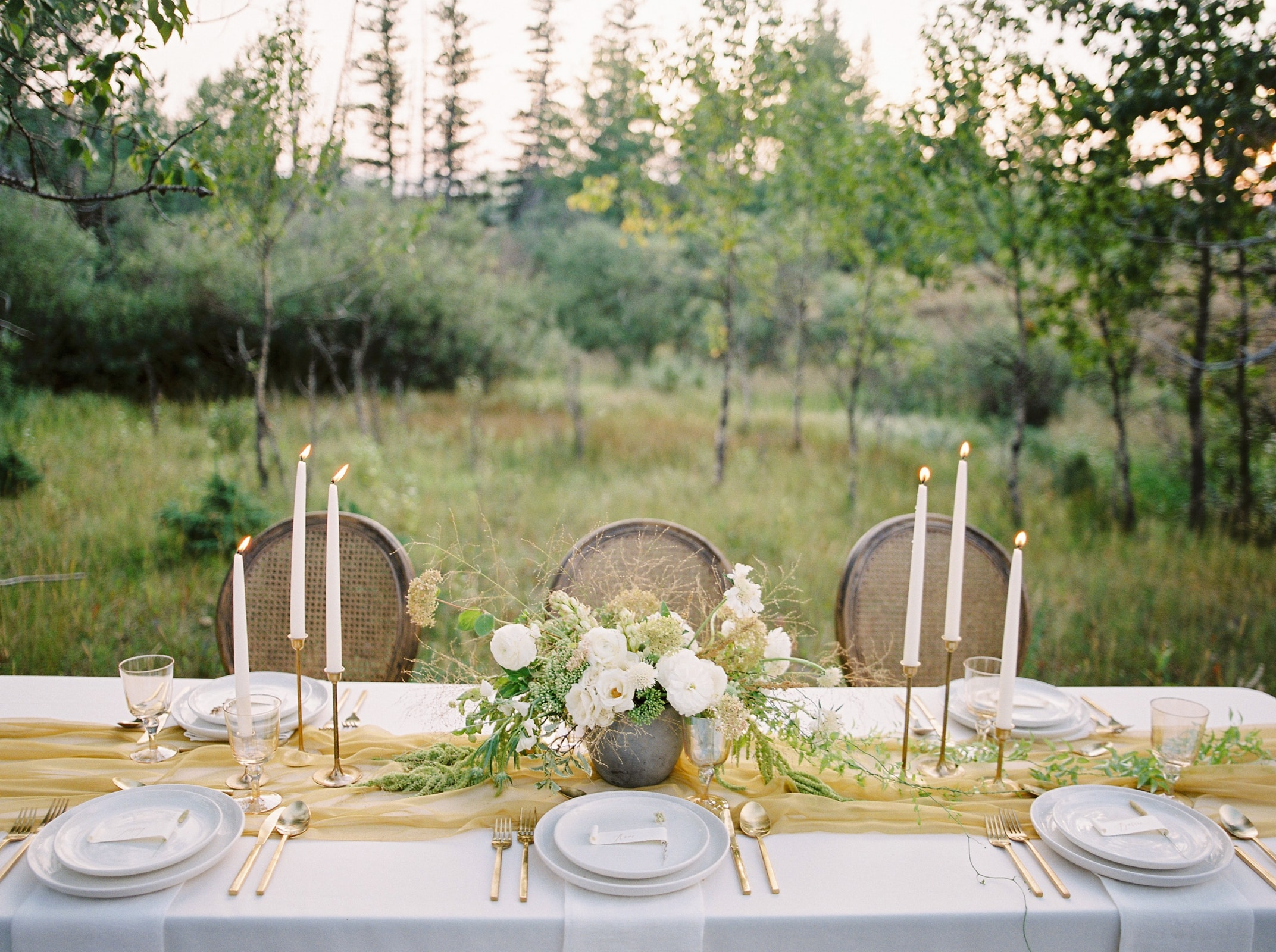 Photos by Justine Milton  Inspired by the natural beauty of Kananaskis Country, this design collaboration was intended to reflect the beautiful setting with fine art sophistication. Thanks to Social + Co. wedding planning for trusting in us to execute their vision.