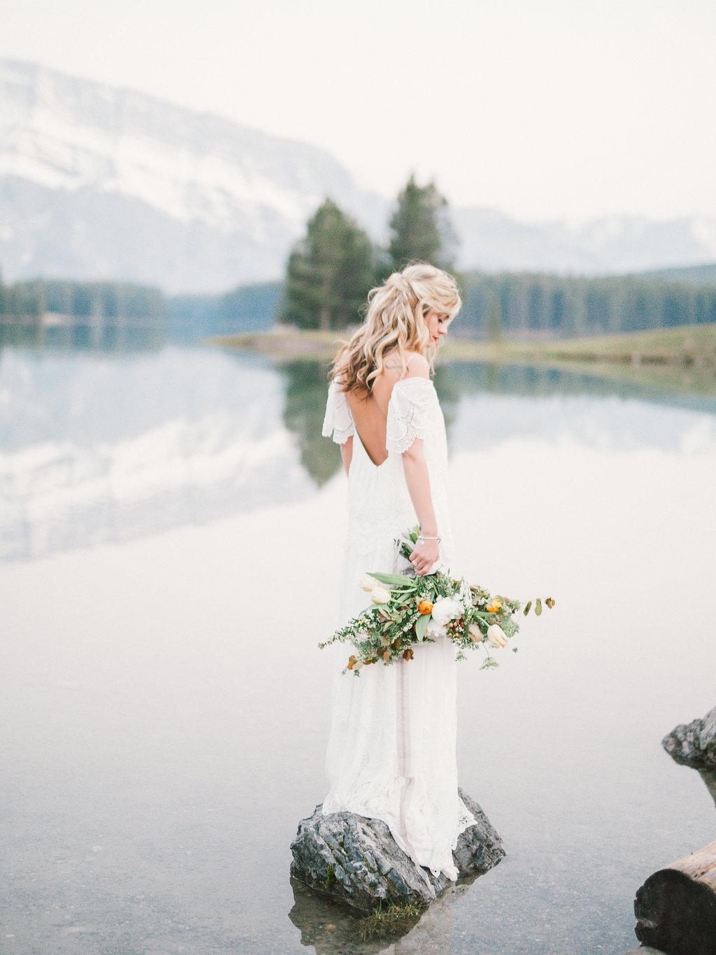 Photos by Julia Park Photography and Cinema  Imagine an adventurous bride spending her free time hiking in the mountains and camping by the bonfire. Her bouquet inspired by wildflowers, the ones the couple were admiring on their first hike together. This Canadian bride is featured in print on the cover of Rocky Mountain Bride Magazine across the U.S. and Canada.