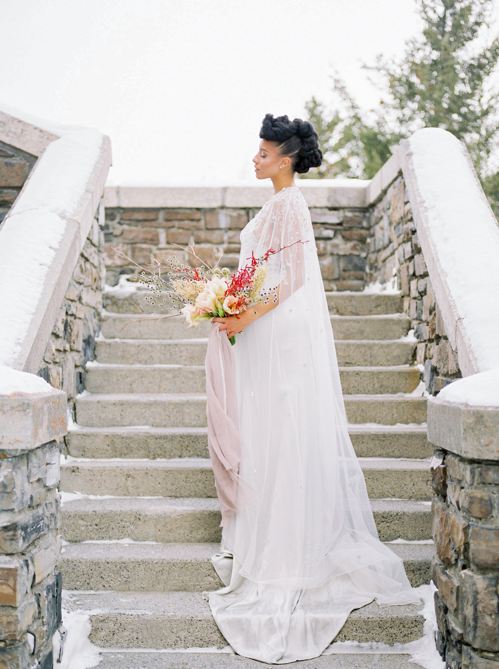 Photos by Pam Kriangkum  The grandest fairytale castle dusted in autumn snow surrounded by the majestic mountains of the Canadian Rockies was the backdrop for this stunning and refined event. This elegant day is featured in print at Grey Likes Weddings.