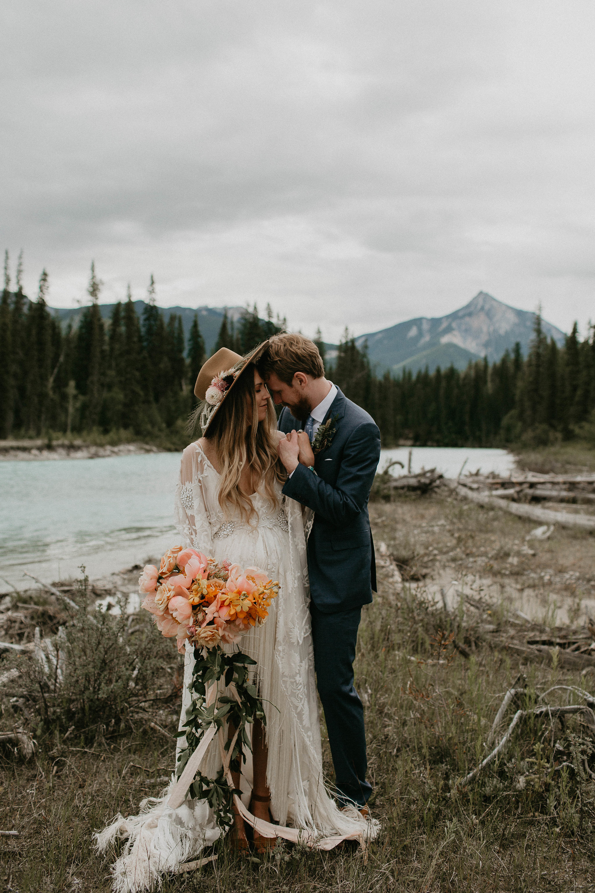 Photos by Michelle Larmand  Traveling to British Columbia with our Free People bride and her charming husband to create a day of easy elegance made for the dreamiest destination wedding. Their free spirits are featured on Confetti Wedding Magazine.
