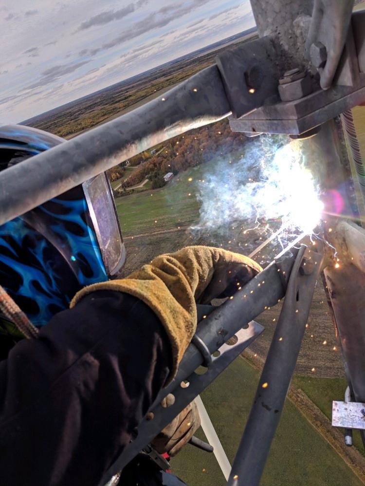 AustinVH_welding at 280' on a 480'GuyedTower_ModWork_GryglaMN_April2019.jpg