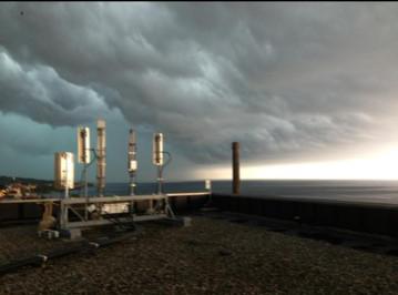 TannerDale_RooptopWork_LookingatLakeSuperior_DuluthRooftop_StormComing in.jpg