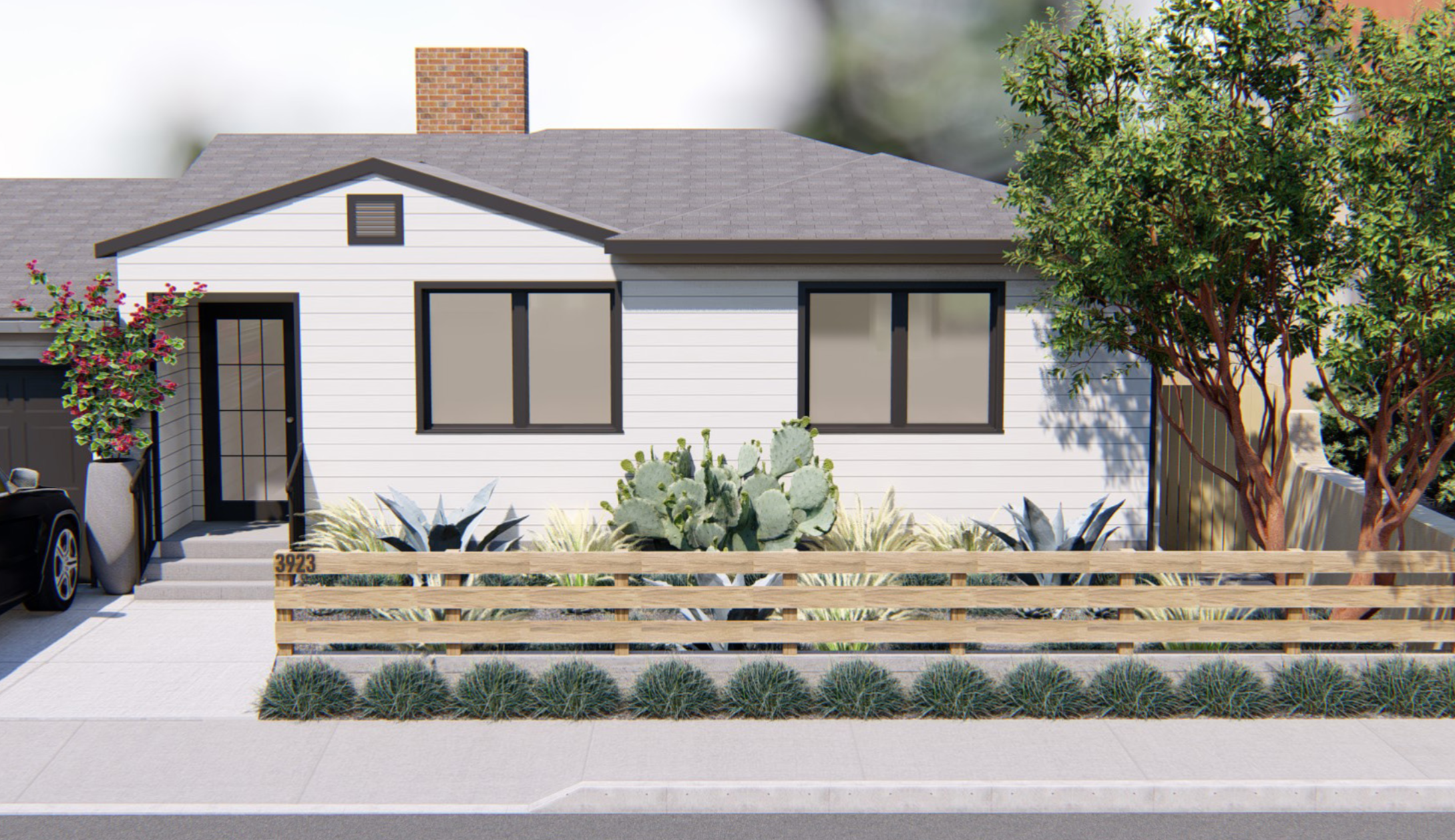 The front yard of the home features the same poured-in-place concrete pavers and beach pebbles that are used in the backyard, and the plantings also coordinate. The fence will be extended with a gate across the driveway.